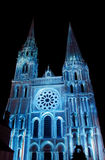 Chartres cathedral illuminated with the night lights. Chartres cathedral with the night lights during the annual performance Chartres en lumieres, France, Europe Stock Images