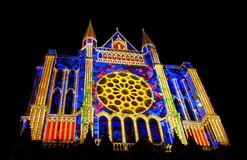 Chartres cathedral with the night lights. During the annual performance Chartres en lumieres, France, Europe. Catholic christian cathedral lightinig at night Royalty Free Stock Image