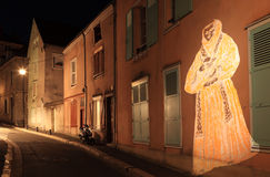 Chartres illumination. Night image of a small street in Chartres during the yearly summer illumination nights. During this time the walls of the cathedral and of Stock Photography