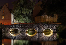 Chartres Illumination. Image of the Pont du Massacre (Massacre Bridge) crossing the Eure river, during the yealry summer illumination nigths in Chartres in the Royalty Free Stock Photos