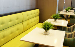 Chartreuse bench with tables Stock Images