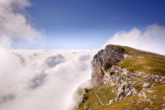 Chartreuse mounts between clouds. A cliff surrounded by clouds Royalty Free Stock Photo