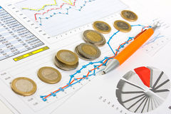 Charts and coins Royalty Free Stock Photography