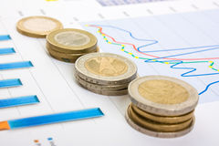 Charts and coins Stock Photos