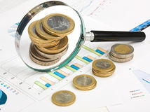 Charts and coins Stock Photography
