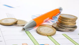 Charts and coins Stock Images