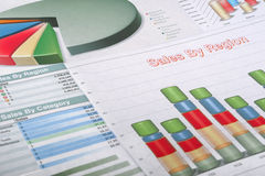 Charts and graphs. Colorful financial schedules and charts on a desktop of the businessman Royalty Free Stock Photography