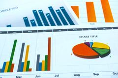 Charts and Graphs paper. Financial, Accounting, Statistics, Analytic research data and Business company meeting concept. Charts and Graphs paper. Financial Stock Images