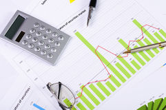 Charts and graphs of sales. Of securities - workplace successful business man Royalty Free Stock Photo