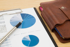 Charts and graphs of sales. On table Stock Photos
