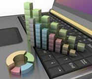 Charts of growth on the keyboard of computer Stock Photo