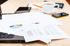 Charts and modern office tools on desk Royalty Free Stock Photo