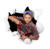 Charwoman. Young woman with vacuum cleaner stock photography