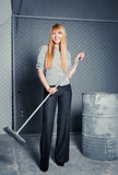 Charwoman with broom Stock Images
