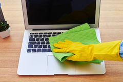 Charwoman cleaning with dry mop laptop Royalty Free Stock Photos