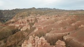 Charyn canyon. Grand canyon. Red sand and rocks. The sky in the clouds. Steep cliffs of the canyon. Shooting with the drone. Unusual footage. Clay rock canyon stock images