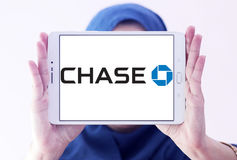 Chase bank logo. Logo of chase bank on samsung tablet holded by arab muslim woman Stock Image
