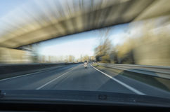 In chase of a chopper. On the highway Stock Images