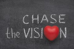 Chase the vision heart. Chase the vision phrase handwritten on blackboard with heart symbol instead of O Stock Photography
