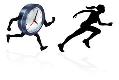 Chased by the Clock Time Pressure. Woman runner racing a clock concept for time pressure or work life balance, being stressed or racing a deadline Royalty Free Stock Photos
