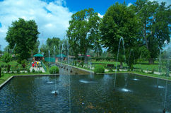 Chashmeshahi Garden Landscape in Srinagar-6. A beautiful scene of a lush green garden in a Kashmir with lot of water fountains and trees Royalty Free Stock Photos