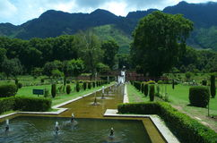 Chashmeshahi Garden Landscape in Srinagar-9. A beautiful scene of a lush green trees with lots of water fountains in a Kashmir in garden Royalty Free Stock Image