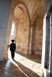 Chasidic man walking through Jaffa Gate Stock Image