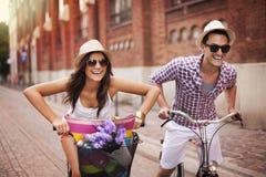 Chasing on bike Stock Image