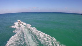 Chasing after boats in Miami Beach stock video footage