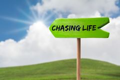 Chasing life arrow sign stock images