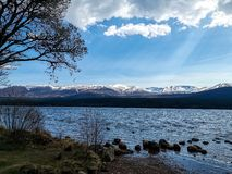 Chasing snow-capped mountains. Chasing snow-capped  mountains aviemore scotland stock photos
