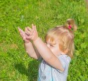 Chasing soap bubbles child. stock photo