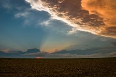 The last light of the sun shines on the anvil of a Texas thunderstorm stock photography
