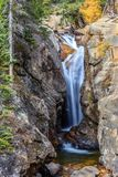 Chasm Falls in Rocky Mountain National Park. Chasm Falls in RMNP in the fall season with the aspen leaves turning gold Stock Images
