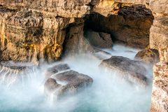 Chasm of Hell's Mouth (In Portuguese Boca do Inferno) located in the city of Cascais. The sea hits the rocks in the tourist attraction of Chasm of Hell's Stock Images