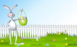 Chasse à oeufs de lapin de Pâques Images stock