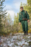 Chasseur is in his hunting grounds in autumn Royalty Free Stock Photo