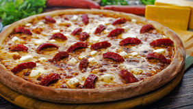Chasseur pizza. Jaeger pizza with sausage and cheese Stock Image
