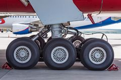Chassis of Boeing 777 close. Close up chassis of modern passenger airplane Boeing 777 Royalty Free Stock Images