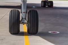 Chassis of Boeing 777 close. Close up chassis of modern passenger airplane Boeing 777 Stock Photos