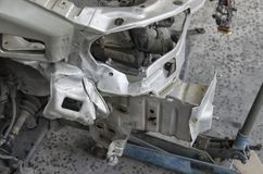 The chassis of a crashed car. Close-up of the chassis of a crashed car Stock Image