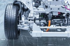 Free Chassis Of The Electric, Hybrid Car With Powertrain. Car Maintenance. Blue Toned. Royalty Free Stock Photo - 113266045