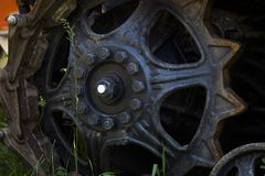 Chassis of the tractor. Close-up details of the wheels and tracks of the tractor tracks. Tracks and links of tractor tracks. Tractor protector with wheels Stock Photo