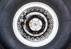 Chassis wheels airplane tire rubber close up. Chassis wheels airplane tire rubber close up Stock Image