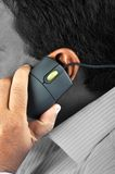 Chat. A man caring a mouse in hand to ear Stock Photos