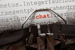 Chat. Word 'chat' written in red color on an old typewriter, detail photo Stock Photography
