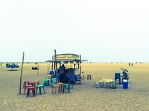 Chat area on Chennai beach. Terrace on the beach of Chennai, public loisir area for the crowded city, where poeple come and relx in open space of the beach Stock Image