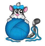 Chat avec l'écheveau bleu Photo libre de droits