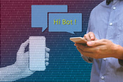 Chat bot and future marketing concept, Man holding smart phone c. Hatting with robot hands communicate with automatic message and binary coded abstract Stock Photos