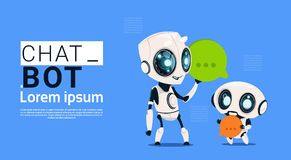 Chat Bot Robots Holding Speech Bubble Banner With Copy Space, Chatter Or Chatterbot Support Service Concept Stock Photography